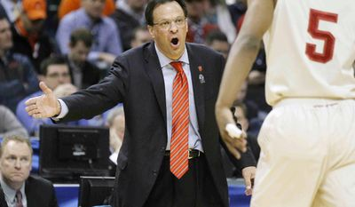 Indiana head coach Tom Crean talks to forward Troy Williams in the first half of an NCAA college basketball game against Illinois in the first round of the Big Ten Conference tournament Thursday, March 13, 2014, in Indianapolis. (AP Photo/Kiichiro Sato)