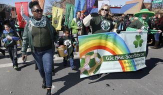 A group standing for diversity marches in the annual St. Patrick's Day parade in the South Boston neighborhood of Boston, Sunday, March 16, 2014. (AP Photo/Michael Dwyer)