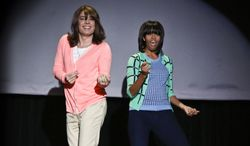 """This image provided by NBC shows Jimmy Fallon, left, and first lady Michelle Obama dancing on the set of Late Night with Jimmy Fallon, Friday Feb. 22, 2013 in New York. The dance was part of Obama's """"Let's Move"""" campaign. (AP Photo/NBC, Lloyd Bishop)"""