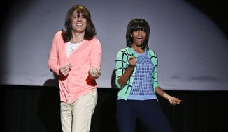 "This image provided by NBC shows Jimmy Fallon, left, and first lady Michelle Obama dancing on the set of Late Night with Jimmy Fallon, Friday Feb. 22, 2013 in New York. The dance was part of Obama's ""Let's Move"" campaign. (AP Photo/NBC, Lloyd Bishop)"