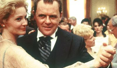 """Actor Anthony Hopkins, playing the title role in Oliver Stone's """"Nixon,"""" dances with actress Joan Allen, who plays former first lady Pat Nixon, in a scene from the film. In a statement released Tuesday, Dec. 19, 1995, by the Richard Nixon Library and Birthplace in Yorba Linda, Calif., Nixon family members lashed out against the film calling the film's script """"character assassination."""" ( AP Photo/Hollywood Pictures, Sidney Baldwin)"""
