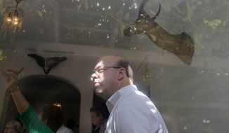 U.S. Congressman Jim McGovern listen's to an guided tour of Ernest Hemingway's former home near Havana, Cuba, Monday, March 17, 2014. Island curators gave the Massachusetts Democrat and a visiting U.S. delegation a rare guided tour inside the modest but graceful Finca Vigia, a hilltop estate that is surrounded by lush tropical fruit trees and boasts panoramic views of the Havana skyline. Scholars from both countries have been working together for more than a decade to preserve the home and its treasure trove of documents, everything from bar bills and bullfighting tickets to personal notes and recipes. (AP Photo/Ramon Espinosa)