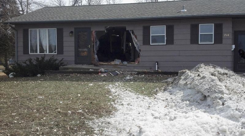 This Sunday, March 16, 2014 photo provided by the North Dakota Highway Patrol shows damage to a house in Oakes, N.D., after  a pickup truck crashed into the house injuring a 28-year-old man inside. The man's wife and 2-year-old daughter were not hurt. The Highway Patrol identified the driver of the pickup as 38-year-old Dale Smith Jr., of Oakes. He was taken to a hospital to be treated for unspecified injuries and arrested on suspicion of drunken driving. (AP Photo/Courtesy of the North Dakota Highway Patrol)
