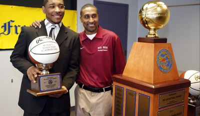 Michigan Mr. Basketball DeShaun Thrower, Muskegon, poses with his high school coach Keith Guy during the announcement of his award at the Detroit Free Press in Detroit on Monday, March 17, 2014. (AP Photo/Detroit Free Press, Julian H. Gonzalez)  DETROIT NEWS OUT;  NO SALES