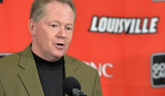 FILE - In this March 8, 2014 file photo, Louisville head football coach Bobby Petrino answers questions during a press conference in Louisville, Ky. Petrino's ongoing transition in his second stint as Louisville's coach continues Tuesday, March 18, 2014, with his first spring practice highlighted by filling several notable voids. (AP Photo/Timothy D. Easley, File)