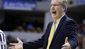 Iowa head coach Fran McCaffery reacts to a call in the first half of an NCAA college basketball game against Northwestern in the first round of the Big Ten Conference tournament, Thursday, March 13, 2014, in Indianapolis. (AP Photo/Michael Conroy)