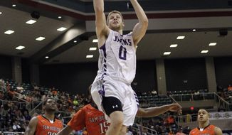 Stephen F. Austin's Thomas  Walkup (0) drives uncontested to the basket for a layup as Sam Houston State's Kaheem Ransom (15), Paul Baxter (21) and  James Thomas (20) watch during the second half of an NCAA college basketball game in the championship of the Southland Conference tournament Saturday, March 15, 2014, in Katy, Texas. Stephen F. Austin won 68-49. (AP Photo/Bob Levey)