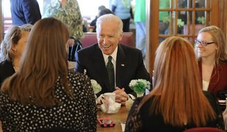 Making a stop at Terry's Diner in Moosic Monday March 17, 2014, Vice President Joe Biden talks with a group of individuals who are working in the community to sign up people for health care coverage before the Marketplace's March 31 enrollment deadline. (AP Photo/The Citizens' Voice, Mark Moran)