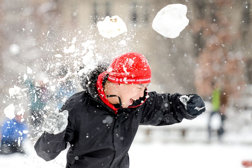 Eric Jeng of Washington, D.C. is hit with an enormous snowball during a snowball fight at Meridian Hill Park, Washington, D.C., Monday, March 17, 2014. (Andrew Harnik/The Washington Times)