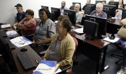 **FILE** Margarita Sanchez (front), 72, of Hollywood, Fla., listens during a job search workshop at WorkForce One in Davie, Fla., on Feb. 6, 2014. (Associated Press)