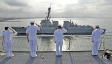 Sailors salute the guided-missile destroyer USS Kidd (DDG 100) from the Military Sealift Command hospital ship USNS Mercy (T-AH 19) as it leaves its home port of San Diego on May 3, 2012. (U.S. Navy photo by Mass Communication Specialist 2nd Class Roadell Hickman/Released)