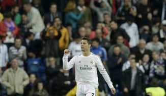 Real's Cristiano Ronaldo celebrates scoring his second goal during a Champions League round of 16, second leg, soccer match between Real Madrid and Schalke 04 at the Santiago Bernabeu stadium in Madrid, Tuesday March 18, 2014. (AP Photo/Paul White)