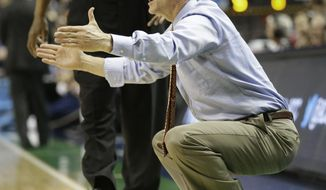 Georgia Tech head coach Steve Donahue directs his team against Boston College during the first half of a first round NCAA college basketball game at the Atlantic Coast Conference tournament in Greensboro, N.C., Wednesday, March 12, 2014. (AP Photo/Gerry Broome)