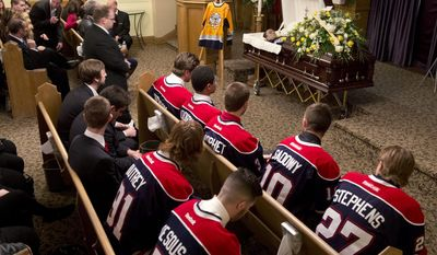Saginaw Spirit hockey players attend a funeral service for teammate Terry Trafford in Toronto, Tuesday, March 18, 2014. The Toronto native's body was found last Wednesday in his SUV in a parking lot in Saginaw Township, Mich. (AP Photo/The Canadian Press, Frank Gunn)