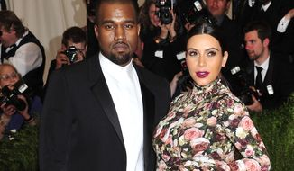 "FILE - In this May 6, 2013 file photo, Kanye West and Kim Kardashian attends The Metropolitan Museum of Art's Costume Institute benefit celebrating ""PUNK: Chaos to Couture"" in New York. A Los Angeles judge on Tuesday March 18, 2014, rejected a motion to dismiss a case filed by Kardashian and West against Chad Hurley, the co-founder of YouTube who posted video of their engagement on his new video-sharing website. (Photo by Charles Sykes/Invision/AP, File)"