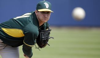 FILE - In this March 5, 2014, file photo, Oakland Athletics' Jarrod Parker throws before an exhibition spring training baseball game against the Milwaukee Brewers in Phoenix. All over spring training, there's been an outbreak of wrecked elbows and pained pitchers. The AL West champion Athletics once again lost Parker to an operation. (AP Photo/Morry Gash, File)