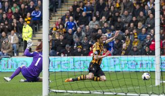 Hull City's George Boyd, centre, falls after a clash with Manchester City's goalkeeper Joe Hart during their English Premier League soccer match at the KC Stadium, Hull, England, Saturday March 15, 2014. (AP Photo/Jon Super)