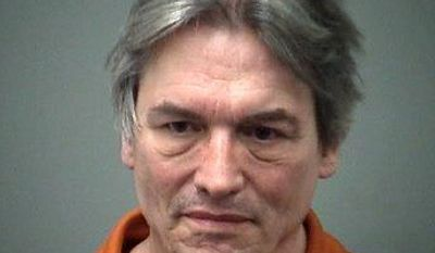 In this undated photo provided by Saginaw County Sheriff's Department via The Saginaw News, Mark Adams is seen. Adams was arrested after authorities said he refused to stop talking past a three-minute time limit for public comment at a township board meeting on March 4, 2014. Adams is scheduled for a preliminary hearing Wednesday, March 19. (AP Photo/Saginaw County Sheriff's Department via The Saginaw News)
