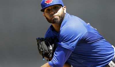 Toronto Blue Jays starting pitcher Ricky Romero throws during the first inning of a spring exhibition baseball game against the Detroit Tigers in Lakeland, Fla., Tuesday, March 18, 2014. (AP Photo/Carlos Osorio)