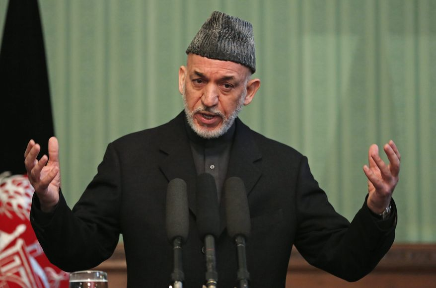 Families of three fallen Navy SEALs are suing Afghan President Hamid Karzai, his security forces and Iran. The lawsuit accuses Mr. Karzai of accepting bribes for the deaths of U.S. servicemen and of leaking details of a SEAL mission to the Taliban. (Associated Press)