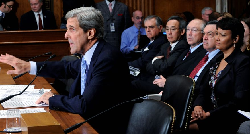 ** FILE ** Sen. John Kerry, D-Mass., left, delivers his opening remarks on Capitol Hill in Washington, Tuesday, Oct. 27, 2009, before the Senate Environment and Public Works Committee hearing on clean energy jobs. Seated behind him , from left are, then Transportation Secretary Ray LaHood, Energy Secretary Steven Chu, Interior Secretary Ken Salazar, Federal Energy Regulatory Commission Chairman  Jon Wellinghoff, and Environmental Protection Agency Administrator Lisa Jackson.  (AP Photo/Susan Walsh)
