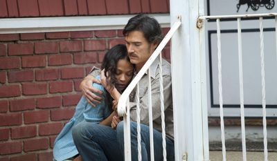 "This image released by Roadside Attractions shows Zoe Saldana, left, and Billy Crudup in a scene from ""Blood Ties."" (AP Photo/Roadside Attractions)"