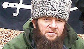 FILE -  In this screen shot taken in Moscow, Wednesday, Dec. 2, 2009 off a  computer screen showing an undated photo of a man identified as Chechen separatist leader Doku Umarov,  posted on the Kavkazcenter.com site. An Islamic militant group in Russia's North Caucasus is reporting the death of its leader, who had threatened to attack Sochi Olympics and was one of Russia's most wanted men. The death of Chechen warlord Doku Umarov has been reported previously, but this appears to be the first time by the organization he headed. (AP Photo/Kavkazcenter.com, file)