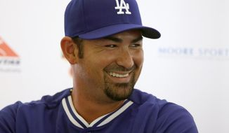 The Los Angeles Dodgers' Adrian Gonzalez laughs during a press conference at the Sydney Cricket Ground in Sydney, Tuesday, March 18, 2014. The MLB season-opening two-game series between the Los Angeles Dodgers and Arizona Diamondbacks in Sydney will be played this weekend. (AP Photo/Rick Rycroft)
