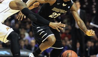 Minnesota's Malik Smith, left, attempts to steal the ball against High Point's Devante Wallace during the first half of an NCAA college basketball game in the first round of the National Invitational Tournament in Minneapolis, Tuesday, March 18, 2014. (AP Photo/Tom Olmscheid)