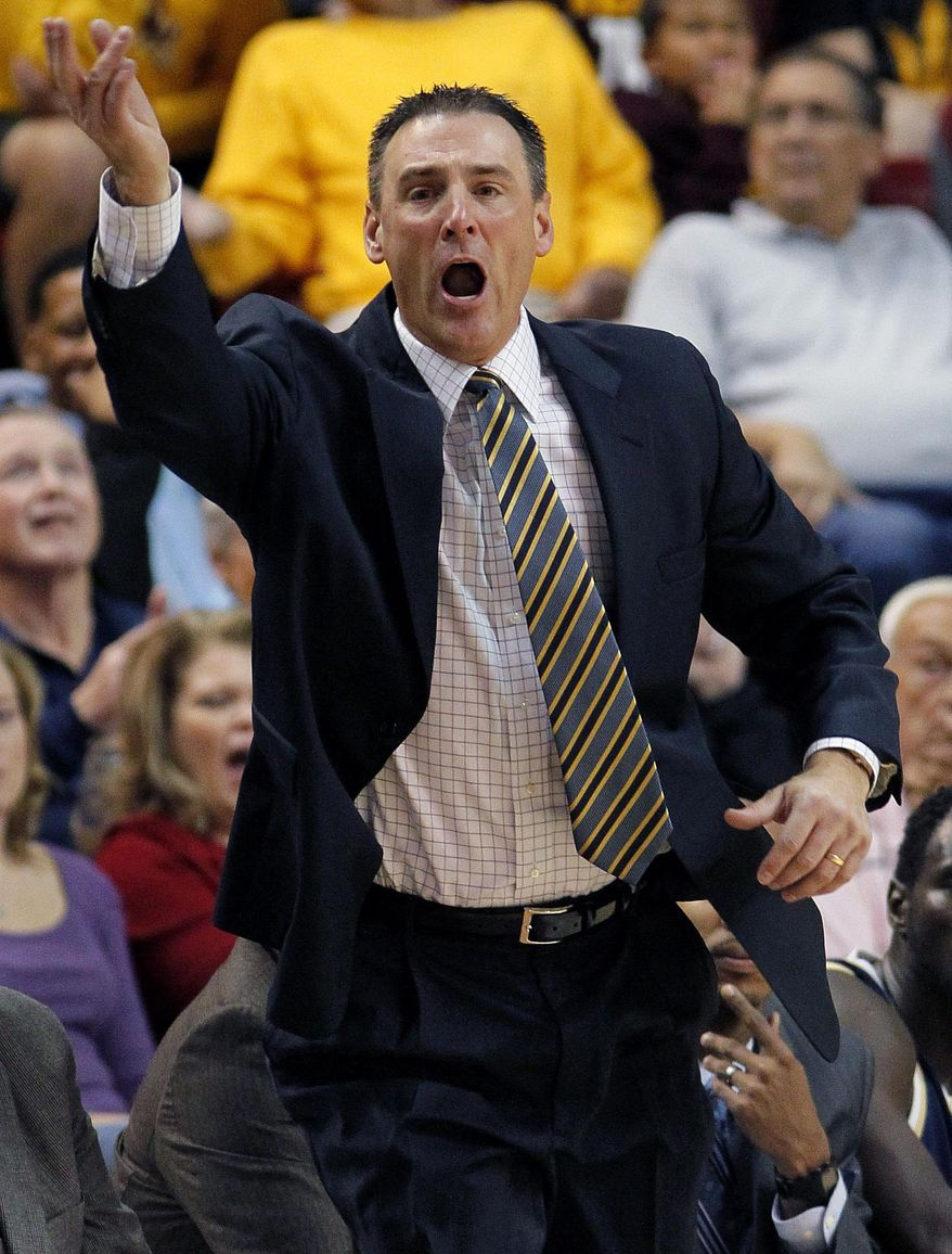 File-This Nov. 11, 2011, file photo shows Montana State head coach Brad Huse yells to his team as they play Arizona State during the first half of an NCAA college basketball in Tempe, Ariz. Huse has resigned after eight seasons. Athletic director Peter Fields says Huse resigned during a meeting between the two on Tuesday March 18, 2014 .(AP Photo/Matt York,File)