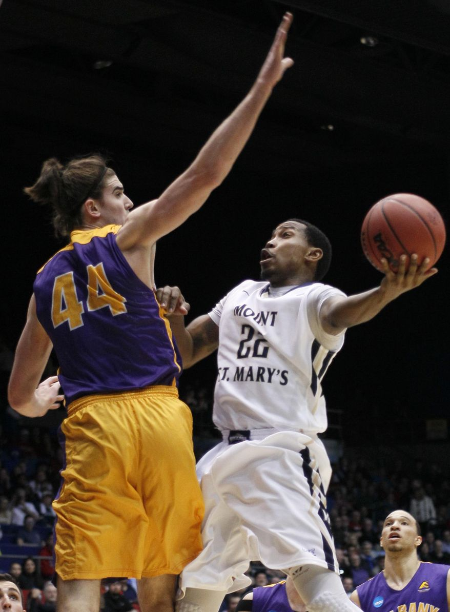 Mount St. Mary's guard Rashad Whack (22) drives against Albany center John Puk (44) during the first half of a first-round game of the NCAA college basketball tournament, Tuesday, March 18, 2014, in Dayton, Ohio. (AP Photo/Skip Peterson)