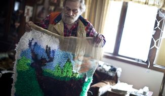 In this photo taken on Monday, March 17, 2014, Bruce Echelberry holds up a needlework design at his home in Milaca, Minn. He had been working project with help from the Riverwood Centers. The center, which provided outpatient clinical and community-based mental health services to several thousand residents in Chisago, Isanti, Kanabec, Mille Lacs, and Pine counties, said county funding cuts has forced it to close its five clinics and an emergency home visiting service. (AP Photo/The Star Tribune, Renee Jones Schneider)  MANDATORY CREDIT; ST. PAUL PIONEER PRESS OUT; MAGS OUT; TWIN CITIES TV OUT