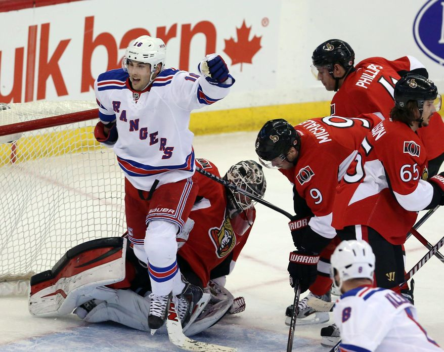 New York Rangers' Derrick Brassard (16) celebrates a goal as Ottawa Senators goaltender Robin Lehner (40) Milan Michalek (9) Chris Phillips (4) and Erick Karlsson (65) look on during second period NHL hockey action in Ottawa Tuesday March 18, 2014. (AP Photo/The Canadian Press, Fred Chartrand)