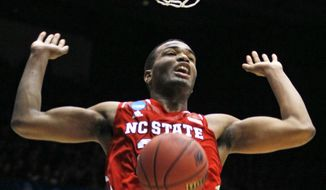 North Carolina State forward T.J. Warren dunks against Xavier in the first half of a first-round game of the NCAA college basketball tournament, Tuesday, March 18, 2014, in Dayton, Ohio. (AP Photo/Skip Peterson)