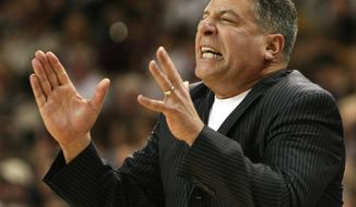 FILE - In this March 6, 2010 file photo, Tennessee head coach Bruce Pearl reacts during the second half of an NCAA college basketball game in Starkville, Miss. Auburn has hired former Tennessee coach Pearl to lead a struggling basketball program. The school announced the hiring on Tuesday, March 18, 2014, of the charismatic coach, who remains under a show-cause penalty from the NCAA. (AP Photo/Kerry Smith, File)