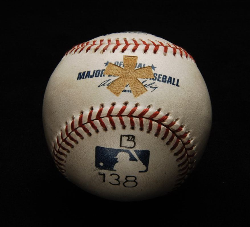 This handout provided by the National Baseball Hall of Fame in Cooperstown, N.Y. shows the baseball Barry Bonds launched for his record 756th home run,  now branded with an asterisk, at the Hall of Fame, Wednesday, July 2, 2008. (AP Photo/HO)