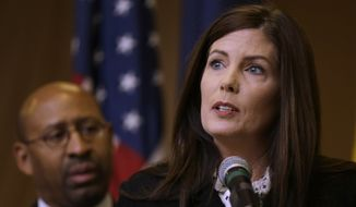 **FILE** Pennsylvania Attorney General Kathleen Kane, accompanied by Philadelphia Mayor Michael Nutter, speaks during a news conference on Feb. 8, 2013, in Philadelphia. (Associated Press)