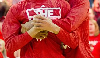 Nebraska player Shavon Shields, right, hugs teammate Terran Petteway after the announcement that Nebraska will participate in the NCAA basketball tournament at the Men's NCAA Selection Show Watch Party at Pinnacle Bank Arena in Lincoln, Neb. on Sunday, March 16, 2014.  (AP Photo/Lincoln Journal Star, Morgan Spiehs)