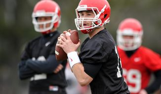 Georgia quarterback Hutson Mason (14) drops back to pass during a Georgia spring football practice on Tuesday, March 18, 2014, in Athens, Ga. (AP Photo/Athens Banner-Herald, AJ Reynolds)