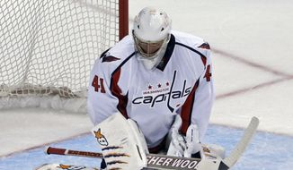 Washington Capitals goalie Jaroslav Halak, of Slovakia, blocks a shot from the Anaheim Ducks during the second period of an NHL hockey game Tuesday, March 18, 2014, in Anaheim, Calif. (AP Photo/Reed Saxon)