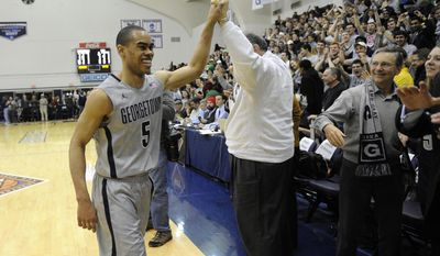 Georgetown guard Markel Starks (5) celebrates 77-65 win over West Virginia with fans as he walks off the court after an NCAA college NIT tournament first round basketball game, Tuesday, March 18, 2014, in Washington. (AP Photo/Nick Wass)
