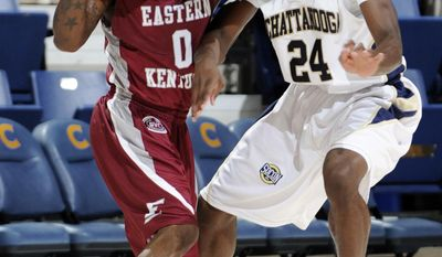 FILE - In this Dec. 8, 2012, file photo, Eastern Kentucky's Glenn Cosey attempts to move past Chattanooga's Casey Jones, right, during an NCAA college basketball game in Chattanooga, Tenn.  Cosey and No. 15 seed Eastern Kentucky in the team's first NCAA tournament appearance since 2007 will face No. 2 Kansas on Friday, March 21, 2014. (AP Photo/Chattanooga Times Free Press, Allison Love, File) THE DAILY CITIZEN OUT; NOOGA.COM OUT; CLEVELAND DAILY BANNER OUT; LOCAL INTERNET OUT