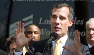 Los Angeles Mayor Eric Garcetti comments during a news conference at Los Angeles International Airport, on Tuesday, March 18, 2014. According to a report released Tuesday the Los Angeles International Airport was ill prepared for a crisis when a gunman ambushed security officers last year, and the emergency response was hindered by communication problems and poor coordination. (AP Photo/Nick Ut)