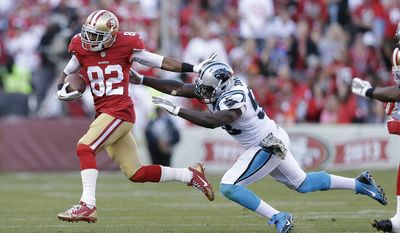 FILE - In this Nov. 10, 2013, file photo, San Francisco 49ers wide receiver Mario Manningham (82) runs past Carolina Panthers outside linebacker Thomas Davis during an NFL football game in San Francisco. Manningham, one of the New York Giants' most productive receivers from 2008-2011, will rejoin the team. (AP Photo/Marcio Jose Sanchez, File)