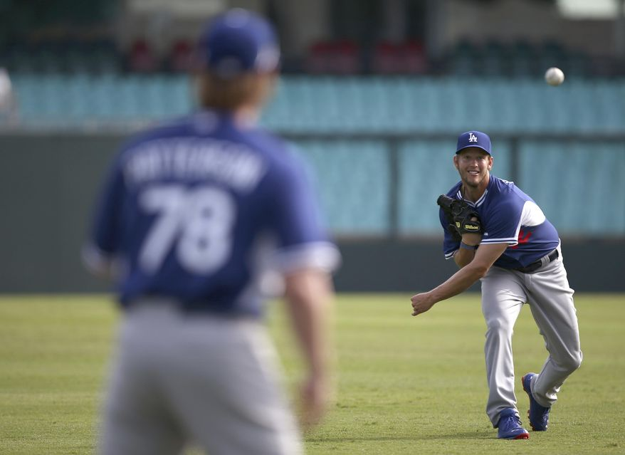 The Los Angeles Dodgers' Clayton Kershaw throws as his team trains at the Sydney Cricket Ground in Sydney, Tuesday, March 18, 2014. The MLB season-opening two-game series between the Los Angeles Dodgers and Arizona Diamondbacks in Sydney will be played this weekend. (AP Photo/Rick Rycroft)