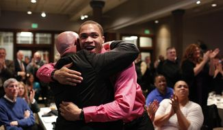 Western Michigan's senior guard David Brown hugs head coach Steve Hawkins, left,  to celebrate the announcement of the school's NCAA basketball tournament placement during Selection Sunday at Cityscape Events Center, Sunday, March 16, 2014, in Kalamazoo, Mich.  (AP Photo/Kalamazoo Gazette-MLive Media Group, ) ALL LOCAL TV OUT; LOCAL TV INTERNET OUT
