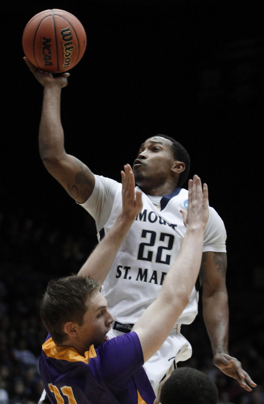 Mount St. Mary's guard Rashad Whack (22) shoots over Albany forward Luke Devlin in the first half of a first-round game of the NCAA college basketball tournament, Tuesday, March 18, 2014, in Dayton, Ohio. (AP Photo/Skip Peterson)