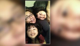 Mindy Tran, 22, is recovering from a broken leg and dislocated shoulder and hip after she lay on the ground behind her Honda Accord to stop it from rolling into the street with her daughters, Saleen and Sydney, still buckled in the back seat. (Mindy Tran via ABC News)