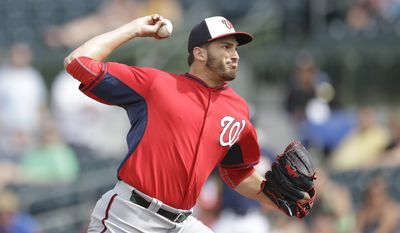 Washington Nationals relief pitcher Christian Garcia throws during the sixth inning of a spring exhibition baseball game against the Houston Astros in Kissimmee, Fla., Sunday, March 16, 2014. (AP Photo/Carlos Osorio)