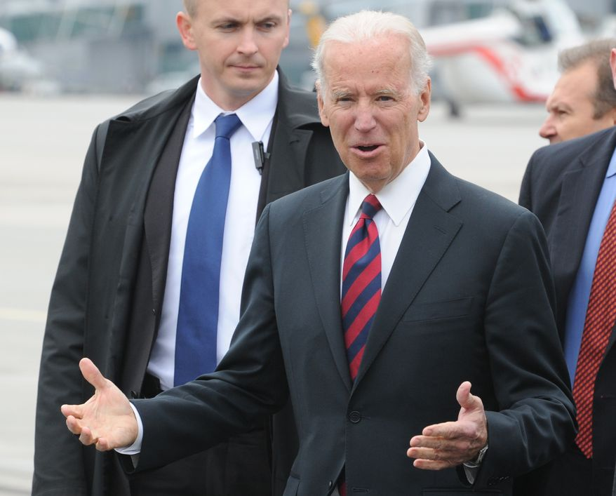 U.S. Vice President Joe Biden gestures as he arrives at the Okecie military airport in Warsaw, Poland, Tuesday, March 18, 2014. Biden arrived in Warsaw for consultations with Polish Prime Minister Donald Tusk and President Bronislaw Komorowski, a few hours after Russian President Vladimir Putin approved a draft bill for the annexation of Crimea, one of a flurry of steps to formally take over the Black Sea peninsula. (AP Photo/Alik Keplicz)